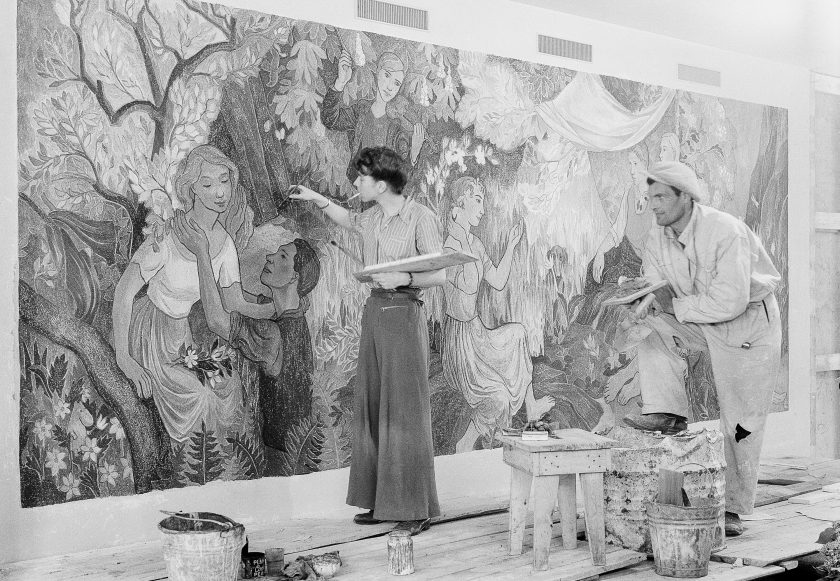 Tove Jansson and Niilo Suihko paint the fresco Juhlat maalla, Party in the country, at the City Hall Restaurant.