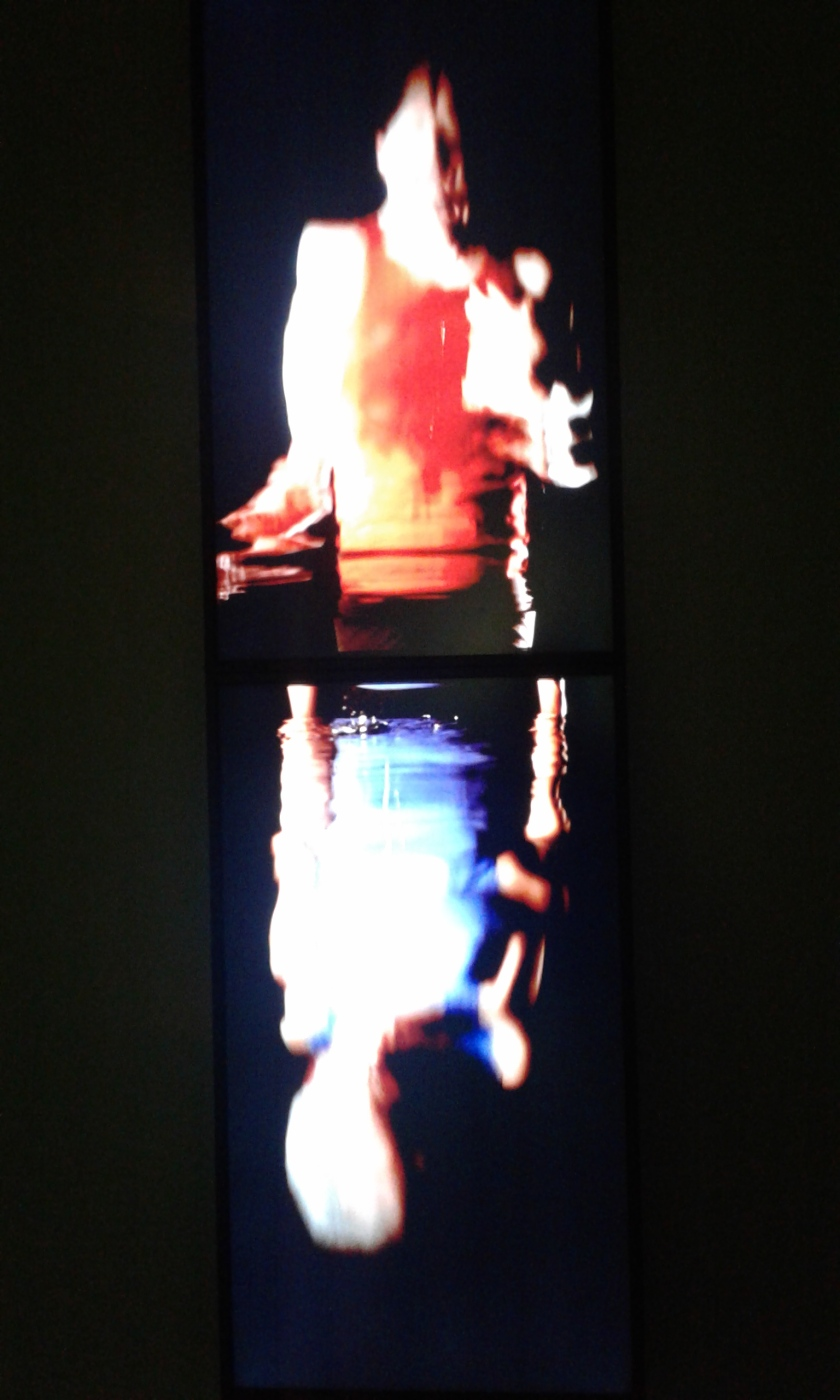 Bill Viola, Surrender, 2001. Color video diptych on two plasma displays mounted vertically on wall; 18:00 minutes. Performers: John Fleck, Weba Garretson.