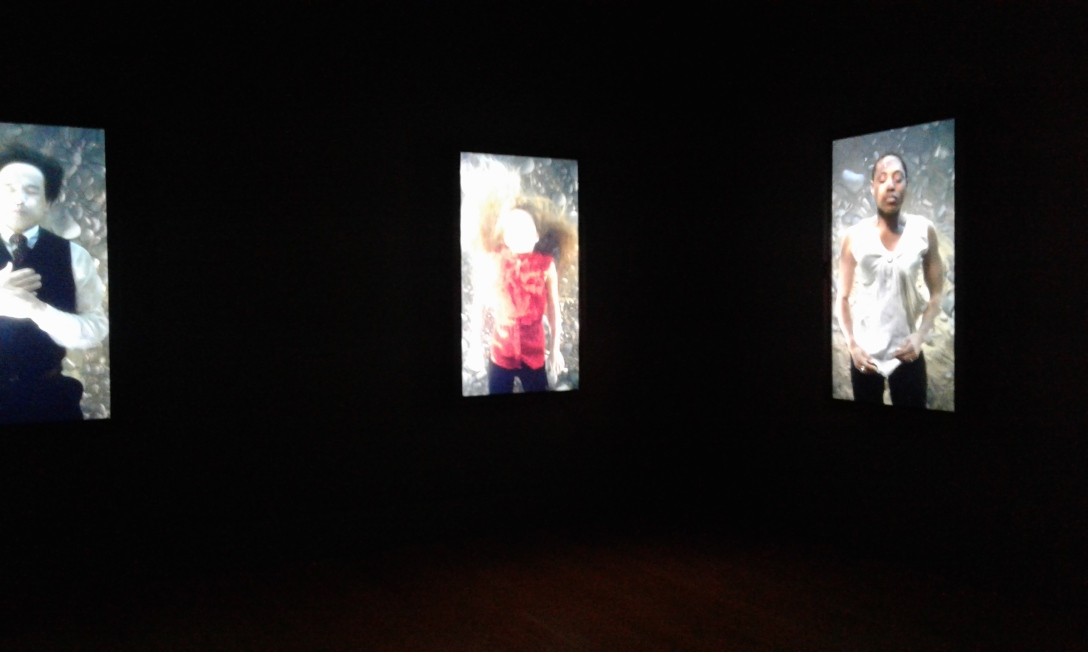 Bill Viola, The Dreamers, 2013, video/sound installation, seven channels of color high-definition video on seven plasma displays mounted vertically on wall. four channels of stereo sound.