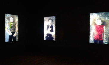 Bill Viola, The Dreamers,2013. Video/sound installation, seven channels of color high-definition video on seven plasma displays mounted vertically on the wall; four channels of stereo sound; installation view at the National Portrait Gallery.