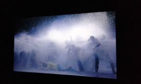 Bill Viola, The Raft, May 2004, video/sound installation. Color high-definition video projection on wall in a darkened space; 5.1 channels of surround sound; 10:33 minutes. Videostill/installation view at the National Portrait Gallery.