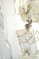 Linda Cunningham's mixed media depict layers of text with sculptural materiality.