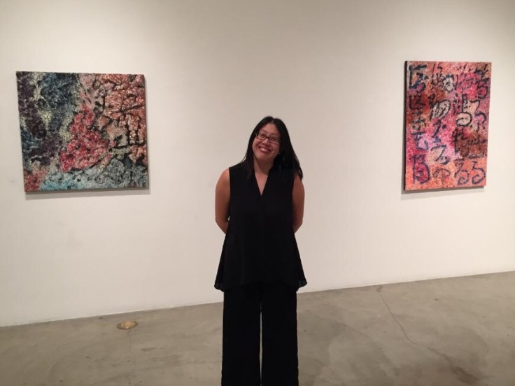 Patricia Chow with her paintings.